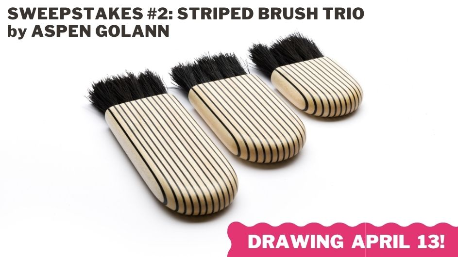 Three handmade striped brushes displayed in an array.